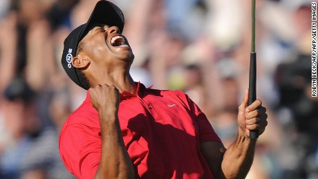 Tiger Woods celebrates his birdie putt on the 18th hole at the US Open on June 15, 2008.