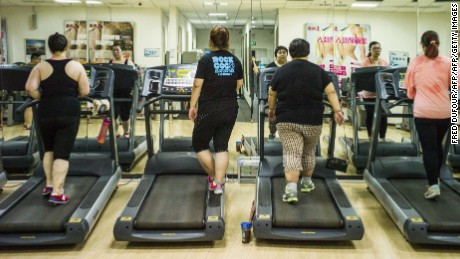 This picture taken on May 25, 2015 shows overweight people having exercise treatment at the Aimin (Love the People) Fat Reduction Hospital in the northern port city of Tianjin.  AFP PHOTO / FRED DUFOUR        (Photo credit should read FRED DUFOUR/AFP/Getty Images)