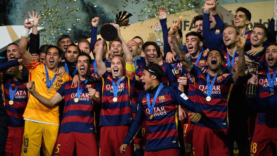Members of FC Barcelona lift the Winner's Trophy after their victory in the FIFA Club World Cup Japan 2015 Final against River Plate at International Stadium Yokohama in Japan on Sunday, December 20.