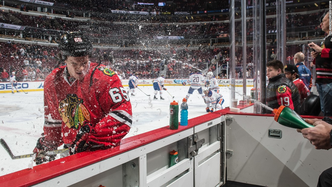 Andrew Shaw of the Chicago Blackhawks is sprayed with water before an NHL game against the Edmonton Oilers at the United Center in Chicago on Thursday, December 17.<br />
