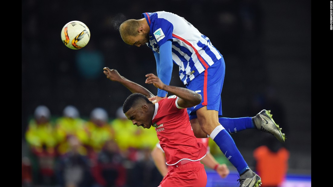 John Anthony Brooks of Hertha BSC dives over Jhon Cordoba of FSV Mainz 05 during a match on Sunday, December 20, in Berlin.