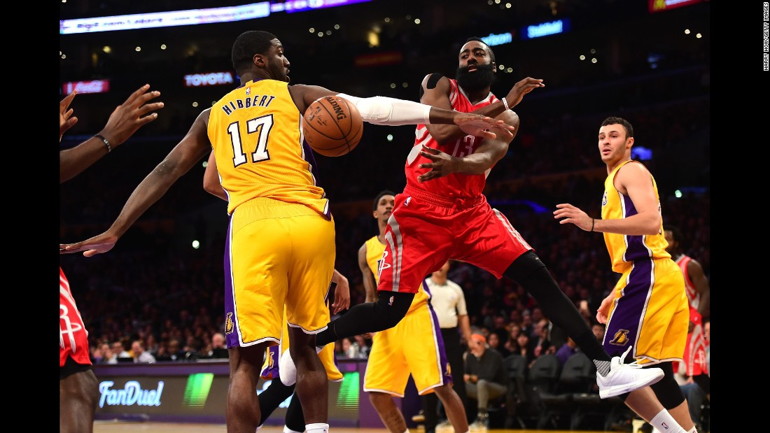James Harden of the Houston Rockets passes behind Roy Hibbert of the Los Angeles Lakers at Staples Center in Los Angeles on Thursday, December 17.<br />