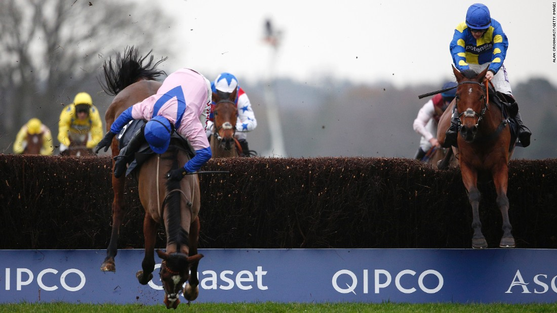 Harry Skelton, riding Amore Alato, falls off his horse during the Mitie Novices' Steeple Chase at the Ascot Racecourse in England on Friday, December 18.<br />