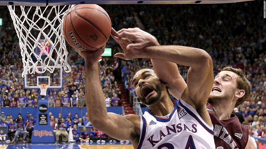 Montana's Jack Lopez fouls Kansas' Perry Ellis as he puts up a shot during the first half of an NCAA college basketball game in Lawrence, Kansas, on Saturday, December 19.