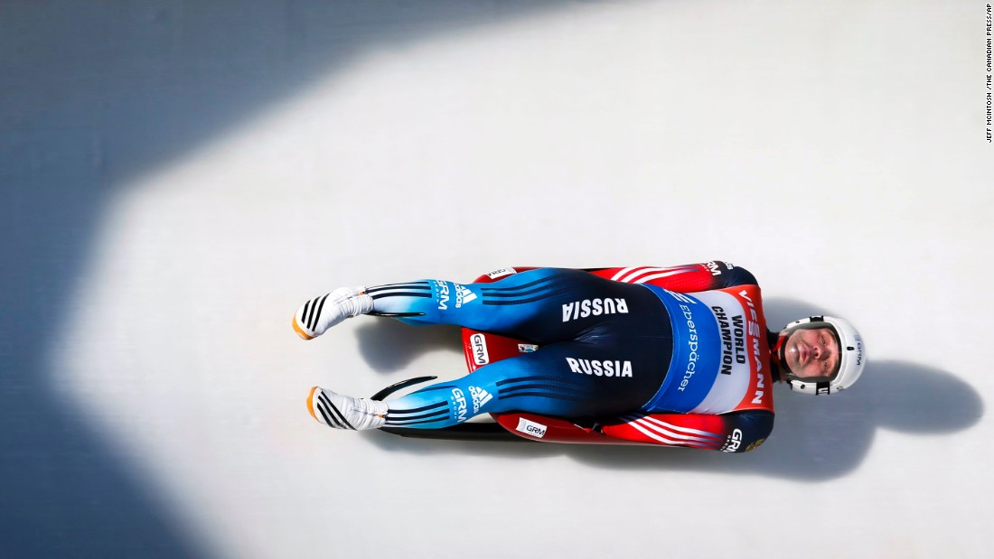 Russia luger Semen Pavlichenko races down the track during the men's World Cup luge competition in Calgary, Alberta, on Saturday, December 19.