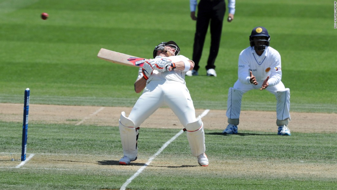 New Zealand's Brendon McCullum ducks against a bouncer from Sri Lanka's Nuwan Pradeep on the second day of the second cricket test in Hamilton, New Zealand, on Saturday, December 19. <br />