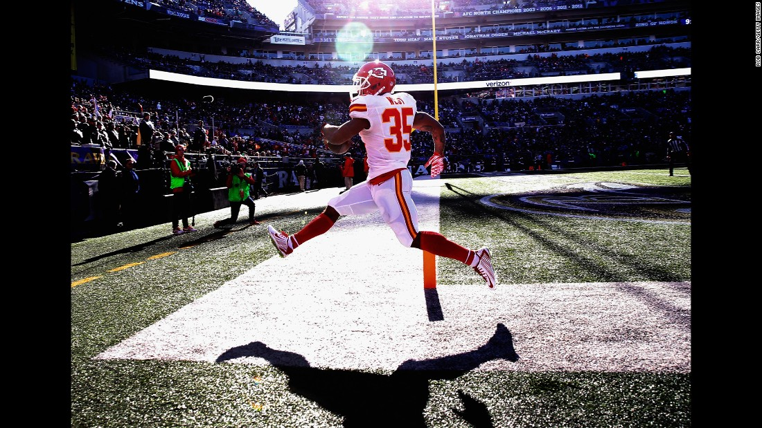 "Running back Charcandrick West of the Kansas City Chiefs celebrates after rushing for a first quarter touchdown against the Baltimore Ravens at M&T Bank Stadium in Baltimore on Saturday, December 20. <a href=""http://edition.cnn.com/2015/12/15/sport/gallery/what-a-shot-sports-1215/index.html"">See 39 amazing sports photos from last week</a>"