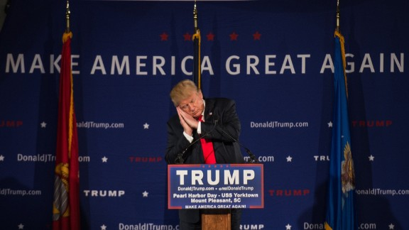 """Trump pretends to sleep December 7 as he references fellow candidate Jeb Bush at a Pearl Harbor Day Rally in Mount Pleasant, South Carolina. It was here that Trump read a press release calling for a """"complete and total shutdown of Muslims entering the United States"""" in light of the San Bernardino terror attacks."""