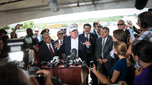 """Trump talks to the media along the U.S.-Mexico border during a trip to Laredo, Texas, on July 23. This is where <a href=""""http://www.cnn.com/2015/07/23/politics/donald-trump-hat-border-tour-laredo/"""">Trump first premiered</a> his """"Make America Great Again"""" hat."""