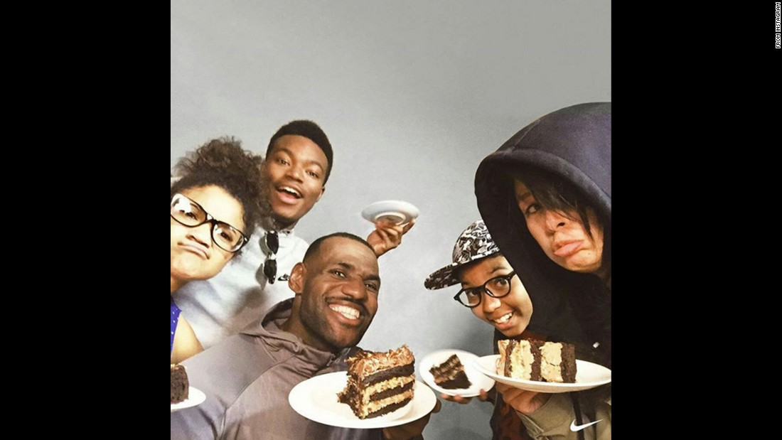 "Lebron James takes a selfie with a group of friends and plates of cake on Thursday, December 17. ""Secret ingredient: kale,"" <a href=""https://www.instagram.com/p/_XiRfwCTEa/"" target=""_blank"">he wrote on Instagram.</a>"