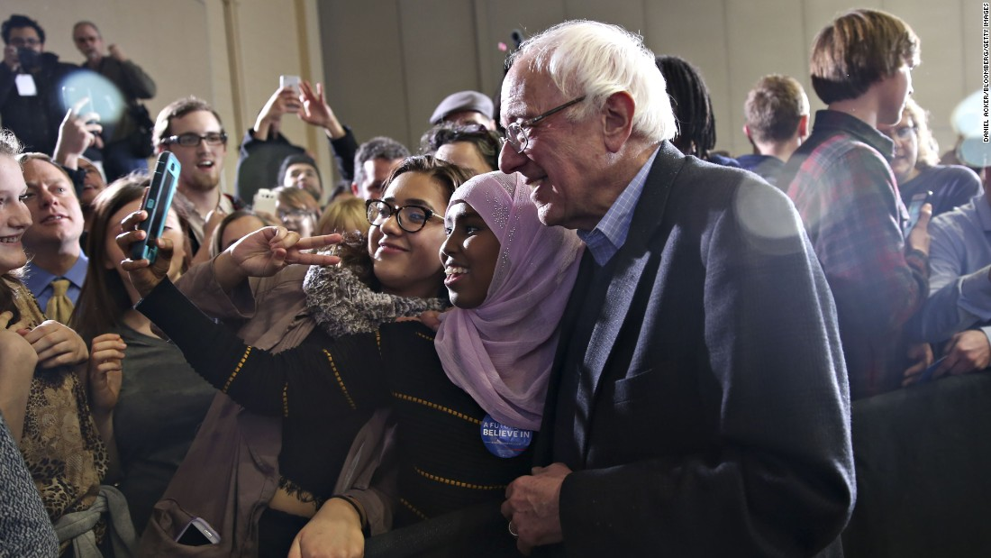 Sen. Bernie Sanders poses for a selfie with an attendee during a rally in Sioux City, Iowa, on Monday, December 21.