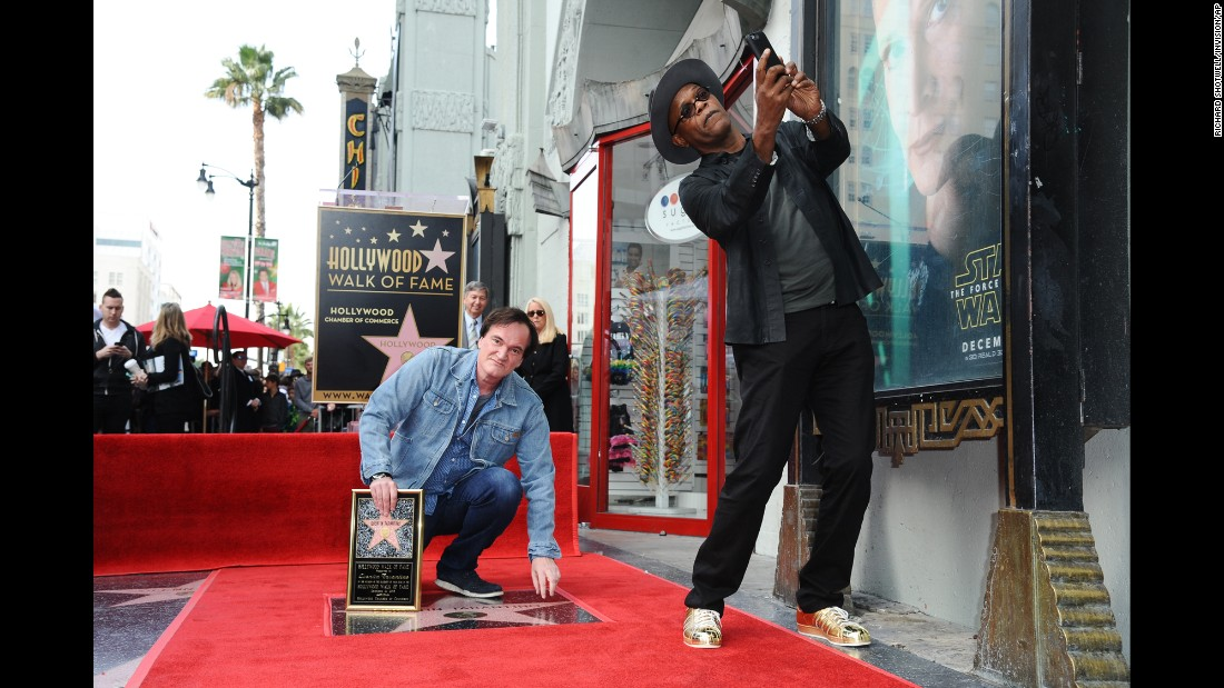 Samuel L. Jackson, standing, takes a selfie with Quentin Tarantino while attending a ceremony honoring Tarantino with a star on the Hollywood Walk of Fame on Monday, December 21.