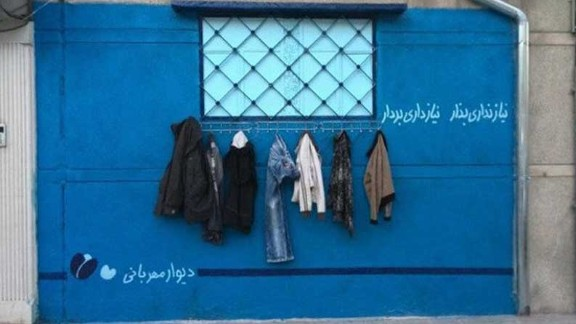 """""""Walls of kindness,"""" where clothes are donated to those in need, have become popular across Iran."""