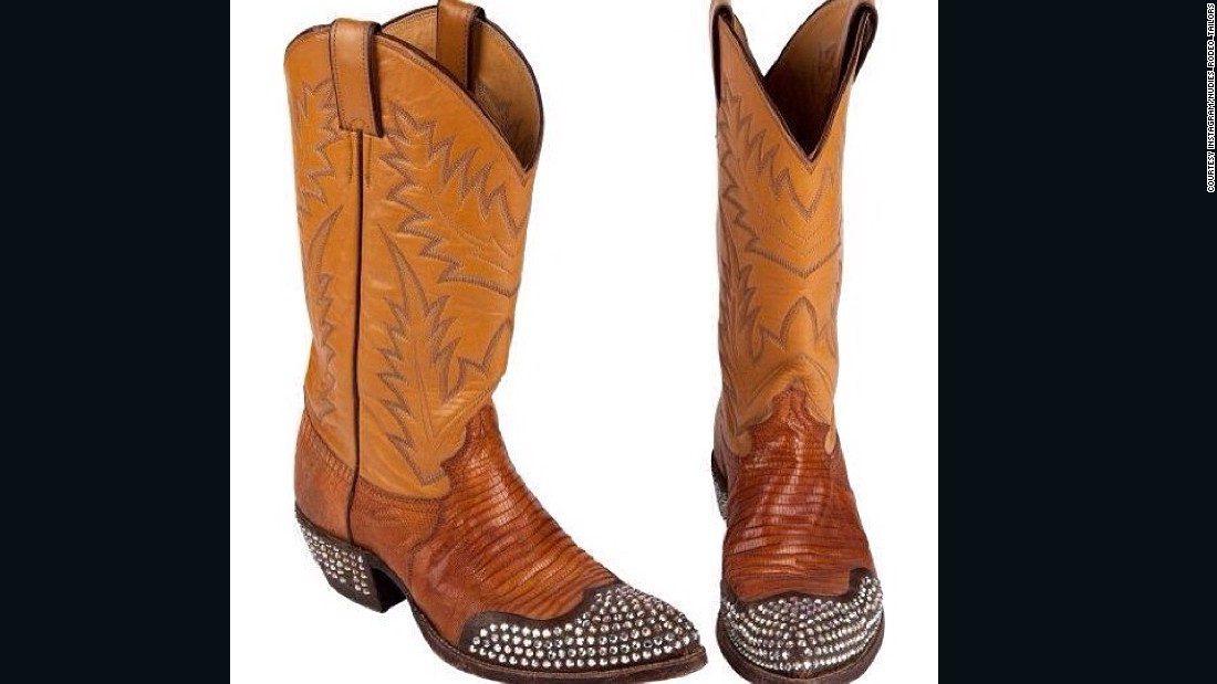 Redford's outfit included these rhinestone-studded boots.