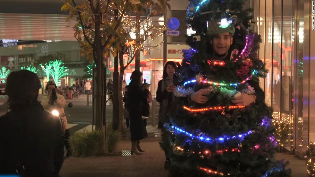 Creative homemade christmas tree and present couple costume