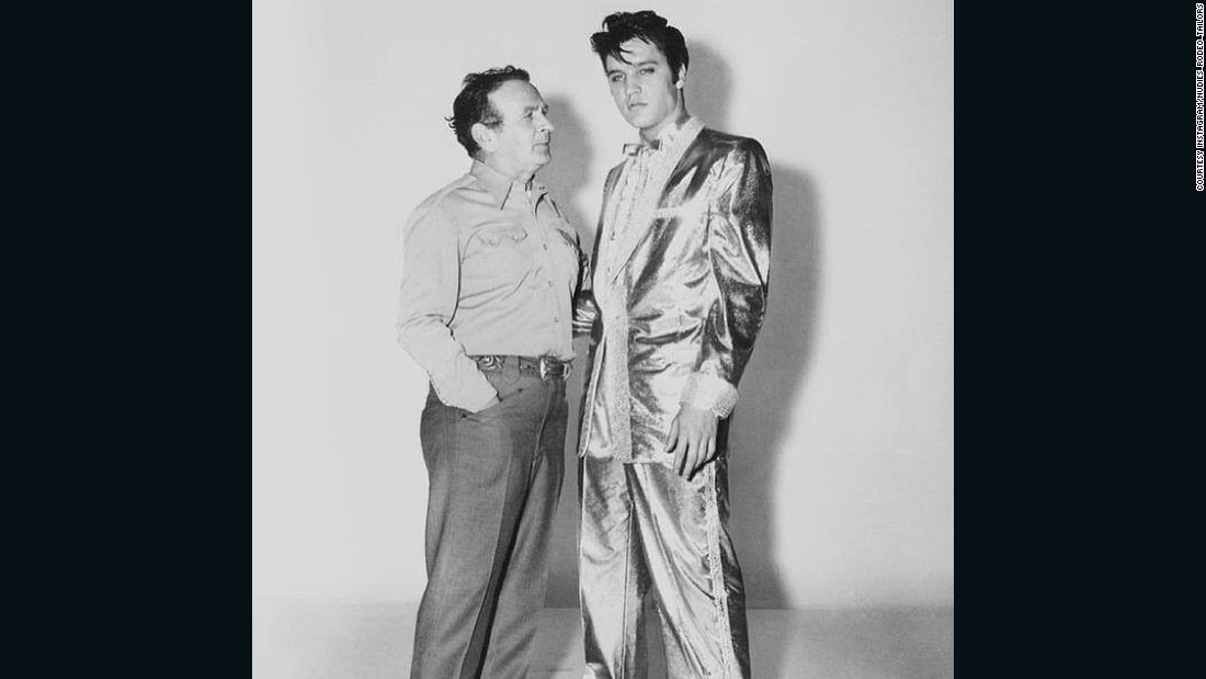 "Cohn's most famous creation was the $10,000 gold lamé suit worn by Elvis Presley on the cover of his album ""50,000 Elvis Fans Can't be Wrong."""