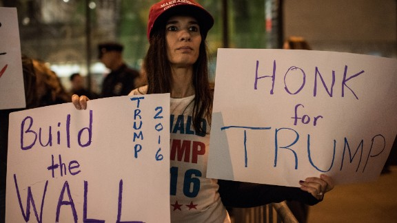 A Trump supporter stands across the street from the Latino protest in New York on November 7.