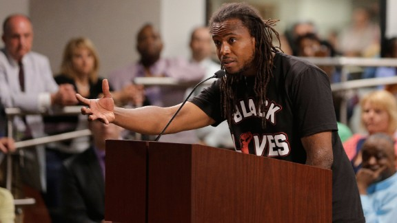 Activist Muhiyidin d'Baha took the call for action into a North Charleston, South Carolina, City Council after the killing of Walter Scott by a North Charleston police officer.