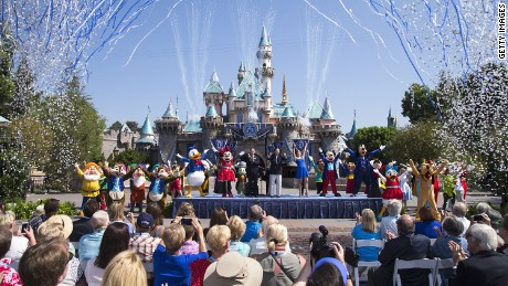 "ANAHEIM, CA - JULY 17:  In this handout photo provided by Disney parks, Mickey Mouse and his friends celebrate the 60th anniversary of Disneyland park during a ceremony at Sleeping Beauty Castle featuring Academy Award-winning composer, Richard Sherman and Broadway actress and singer Ashley Brown July 17, 2015 in Anaheim, California.  Celebrating six decades of magic, the Disneyland Resort Diamond Celebration features three new nighttime spectaculars that immerse guests in the worlds of Disney stories like never before with ""Paint the Night,"" the first all-LED parade at the resort; ""Disneyland Forever,"" a reinvention of classic fireworks that adds projections to pyrotechnics to transform the park experience; and a moving new version of ""World of Color"" that celebrates Walt Disneys dream for Disneyland.  (Photo by Paul Hiffmeyer/Disneyland Resort via Getty Images)"