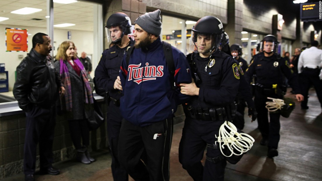 Law enforcement officers detain a protester at the Mall of America in Bloomington, Minnesota, on Wednesday.