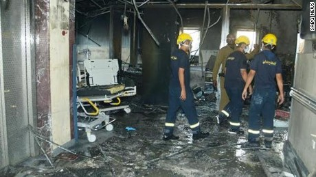 Firefighters search the hospital after the fire.