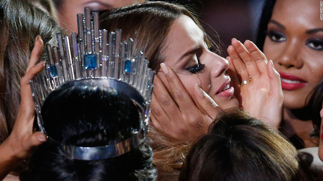 "<strong>December 20: </strong>Pageant contestants comfort Miss Colombia Ariadna Gutierrez <a href=""http://www.cnn.com/2015/12/20/us/miss-universe-wrong-contestant-crowned/index.html"" target=""_blank"">after she learned she was incorrectly crowned Miss Universe</a>. Pageant host Steve Harvey initially named Gutierrez as the winner but corrected himself and announced Miss Philippines Pia Alonzo Wurtzbach as Miss Universe."