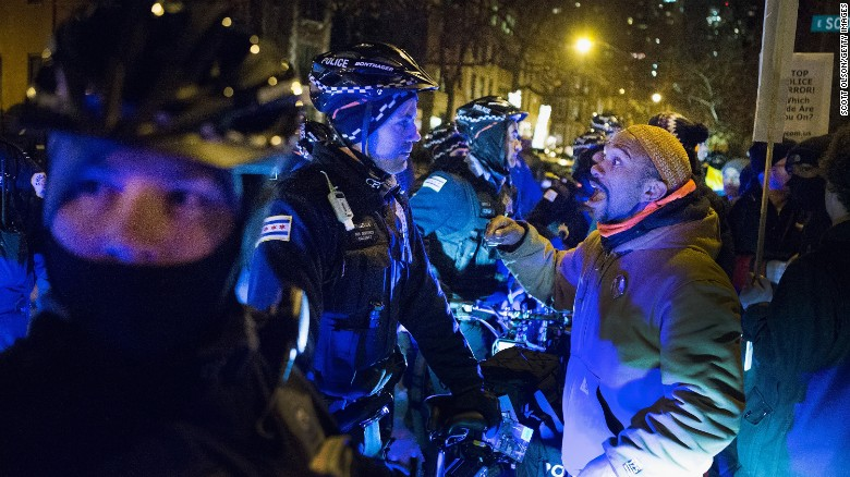 Police blocked off a street as demonstrators marched in Chicago in December 2015. A video showing the shooting of Laquan McDonald by a Chicago police officer sparked almost daily protests in the city at the time.