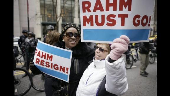 Protesters use the design of the Chicago flag for their placards demanding the mayor's resignation.