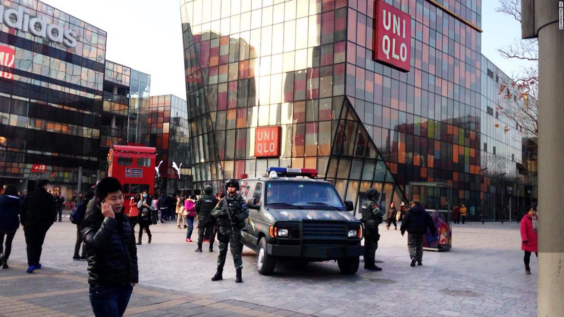 Armed police officers patrol the Sanlitun area of Beijing on December 24, 2015. The British and U.S. embassies in China say they have received information of possible threats against Westerners at and around Christmas in the popular district home to a high-end, open-plan mall and some of Beijing's best dining in Western cuisines.
