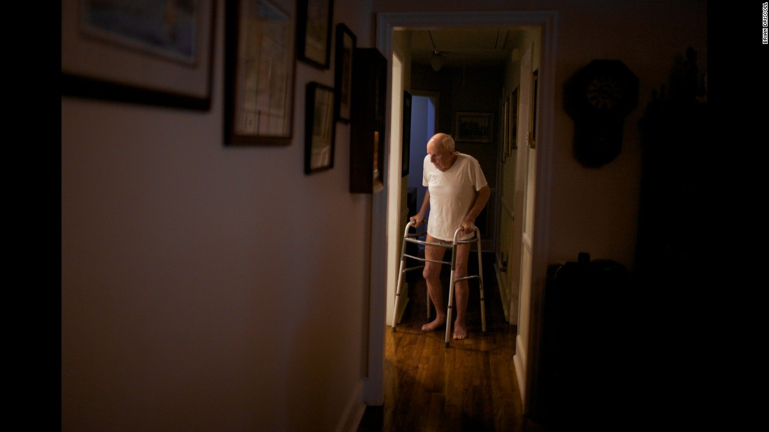 Frampton walks into the kitchen of his Cayce home as his daughter, Christine Power, waits to help him get dressed and prepare for the day. Before his death, Frampton had throat cancer, rheumatic fever and pneumonia.
