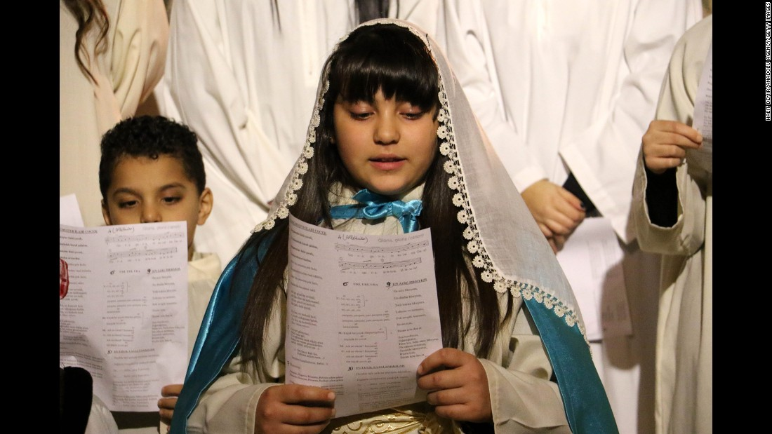 Children sing in a chorus at a Christmas church service at Antakya Orthodox Church in Hatay, Turkey, on Thursday.