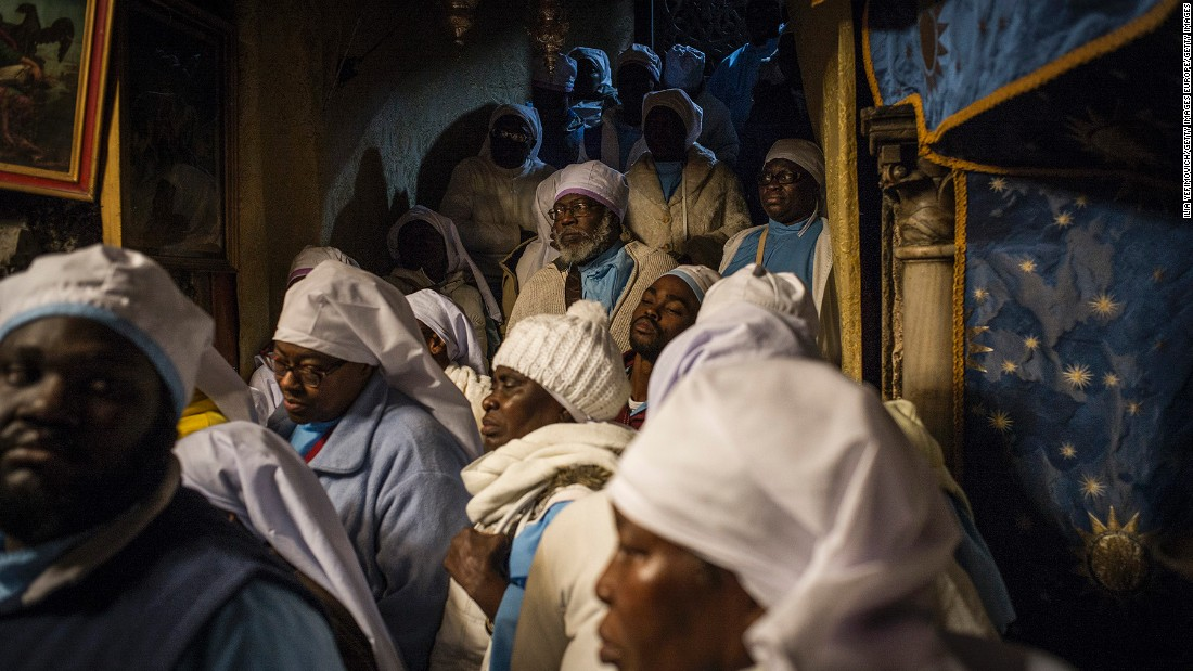 Nigerian pilgrims gather at the Church of the Nativity in Bethlehem, West Bank, on Thursday. Every year, thousands of Christian pilgrims travel to the church, which marks the site of the cave in which Jesus is said to have been born.