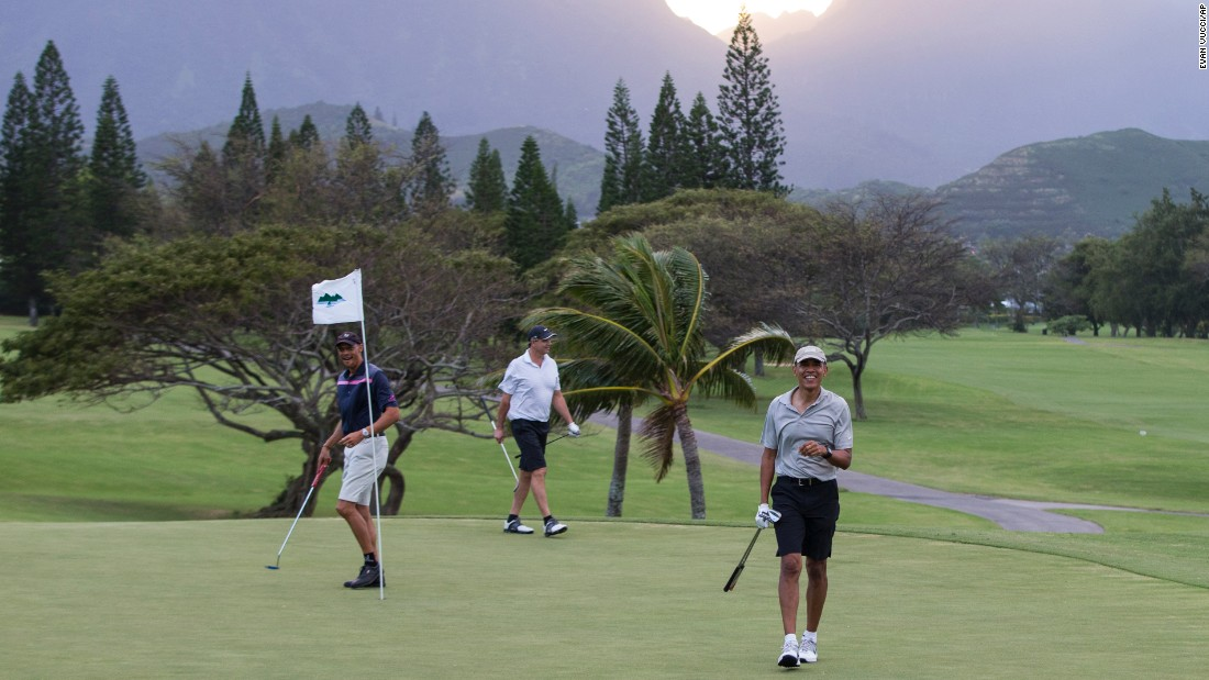 "President Barack Obama, right, plays golf <a href=""http://www.cnn.com/2015/12/22/politics/potus-president-obama-hawaii-holiday-vacation-christmas-ar-origwx/"" target=""_blank"">while on vacation</a> at Mid-Pacific Country Club, on Monday, December 21, in Kailua, Hawaii."