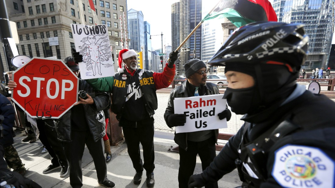 "Protesters call for the <a href=""http://www.cnn.com/2015/12/24/us/chicago-protests-michigan-avenue-laquan-mcdonald/"" target=""_blank"">resignation of Mayor Rahm Emanuel</a>, before a march down Chicago's Magnificent Mile, Thursday, December 24, 2015, in Chicago. The Christmas Eve day protest was the second major demonstration since Thanksgiving weekend condemning how local officials took more than a year to release a police video showing an officer firing 16 shots in 15 seconds toward black teenager Laquan McDonald, who was killed."