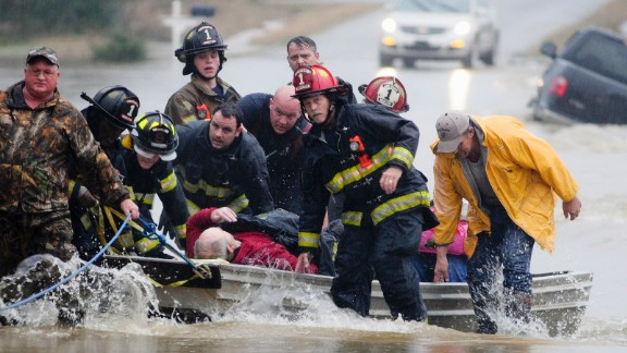 Emergency officials in Moulton, Alabama, transport James Simmons by boat on December 25 after flooding prevented them from reaching him any other way. Unseasonably warm weather helped spawn severe storms Friday after violent storms in the Southeast left dozens of families homeless on Christmas Eve.