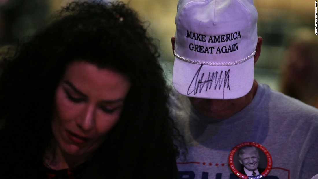 A supporter of Donald Trump wears a hat with Trump's autograph on it during a campaign rally in Las Vegas on December 14.
