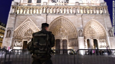 A French serviceman stands guard outside the Cathedral of Notre Dame de Paris on Christmas.