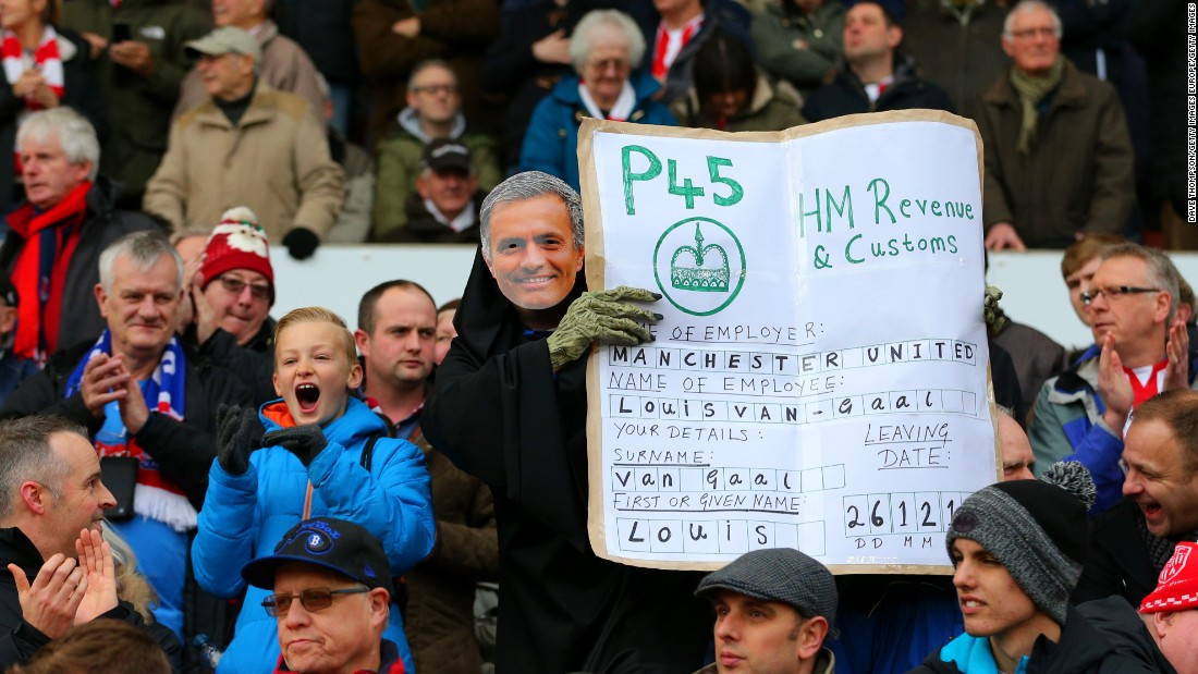 "A Stoke fan wears a Jose Mourinho mask and poses with a ""P45"" slip (which is handed to UK workers when they are fired from or leave a job) for Van Gaal, suggesting the Dutchman will be sacked by United and replaced by the former Chelsea boss."
