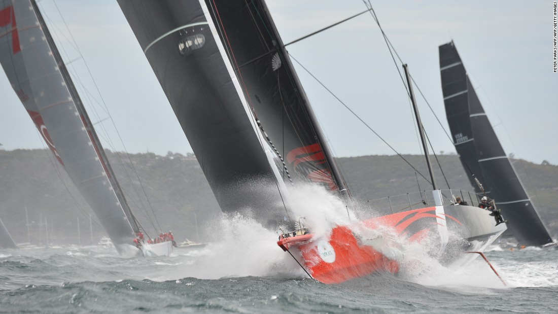 Here, supermaxi Comanche (center) leads Perpetual Loyal (right) and Wild Oats XI (left) at the start of the race coming out of Sydney Harbor on December 26, 2015.