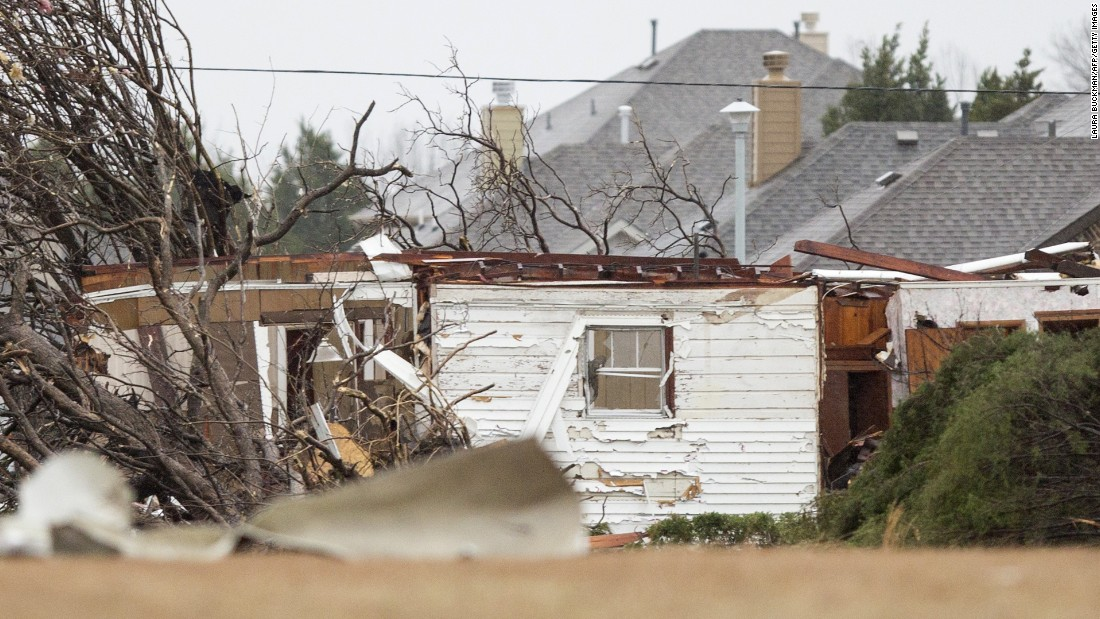 Tornado damage is seen in a neighborhood in Garland on December 27.