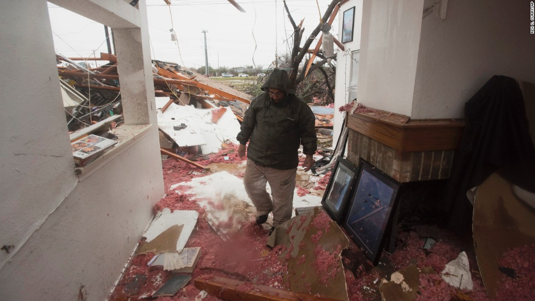 Bob Moore walks through his home in Rowlett the morning after it was hit by a tornado.