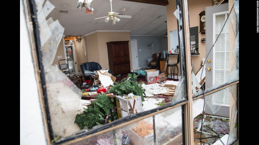 A Christmas tree lies in the wreckage of a family's home in Rowlett on December 27.