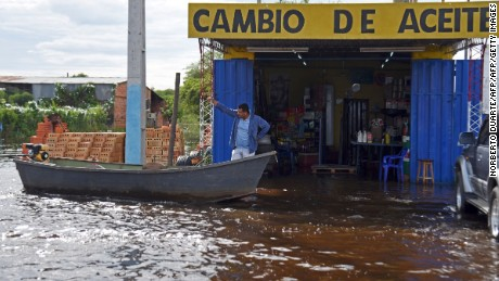 View of a flooded area in Falcon, 42 km west from Asuncion, in the Paraguay-Argentina border on December 26, 2015. Flooding dampened Christmas celebrations in parts of Latin America, leaving five people dead and driving almost 150,000 from their homes in Paraguay, Argentina and Uruguay.