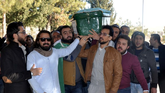 People on Monday carry the coffin of filmmaker Naji Jerf, who was killed  December 27, in Gaziantep, Turkey.