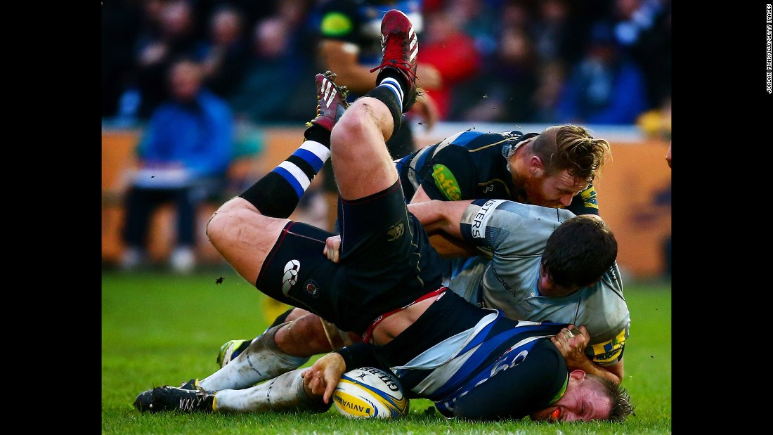 Bath rugby player Max Lahiff is tackled by Worcester's Donncha O'Callaghan during a Premiership match in Bath, England, on Sunday, December 27.