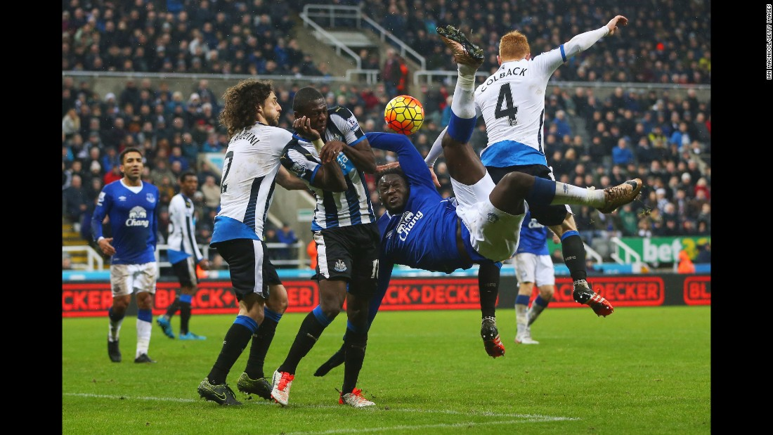 Newcastle players collide with Everton's Romelu Lukaku as he tries an overhead kick Saturday, December 26, in Newcastle upon Tyne, England.
