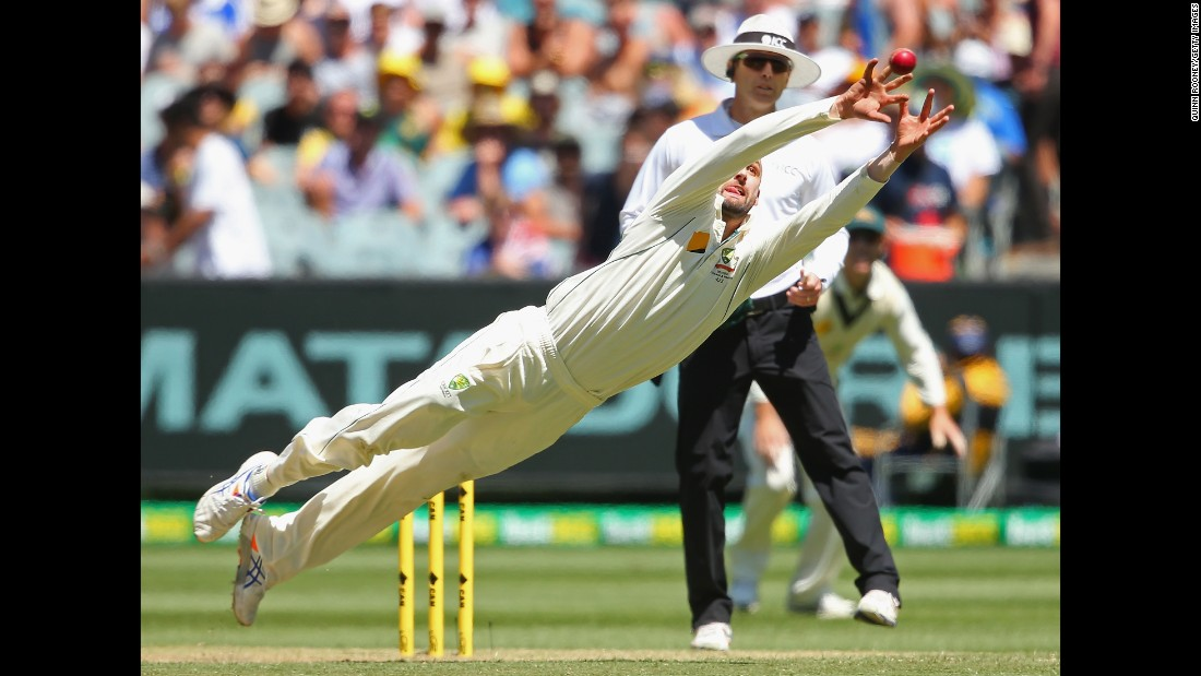 Australian cricketer Nathan Lyon dives for a catch during a Test match against the West Indies on Sunday, December 27.