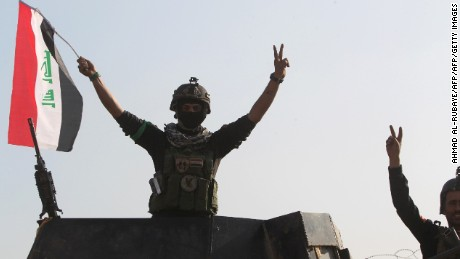 "Members of Iraq's elite counter-terrorism service flash the ""V"" for victory sign on December 28, 2015 at the heavily damaged government complex after they recaptured the city of Ramadi, the capital of Iraq's Anbar province, about 110 kilometers west of Baghdad, from Islamic States group jihadists. Iraq declared the city of Ramadi liberated from the Islamic State group and raised the national flag over its government complex after clinching a landmark victory against the jihadists. AFP PHOTO / AHMAD AL-RUBAYEAHMAD AL-RUBAYE/AFP/Getty Images"