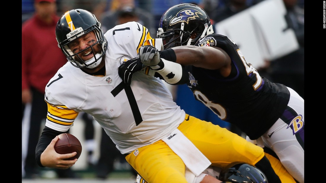 Elvis Dumervil, right, sacks Pittsburgh quarterback Ben Roethlisberger during an NFL game in Baltimore on Sunday, December 27. Baltimore upset its division rival 20-17, damaging its playoff hopes.