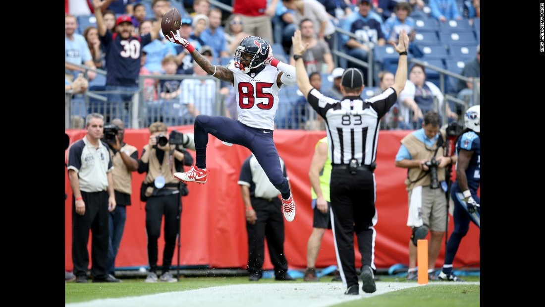 Nate Washington celebrates after he scored a touchdown for Houston during an NFL game in Nashville, Tennessee, on Sunday, December 27. The Texans won 34-6 and moved closer to a division title.